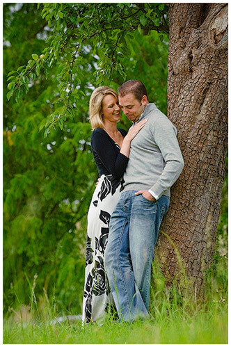 Pre-Wedding Photography shoot in Cambridgeshire couple embrace leaning against tree