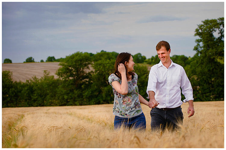Pre-Wedding Shoot Leighton Bromswold happy couple in barley field