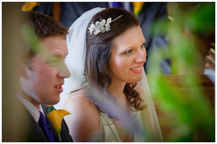 vintage Style Wedding Cambridgeshire smiling bride and groom during ceremony