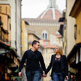 adam and nichola walking hand in hand in florence during their pre-wedding session