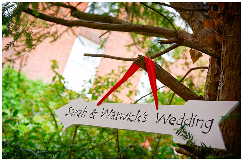 arrow sign pointing way to wedding