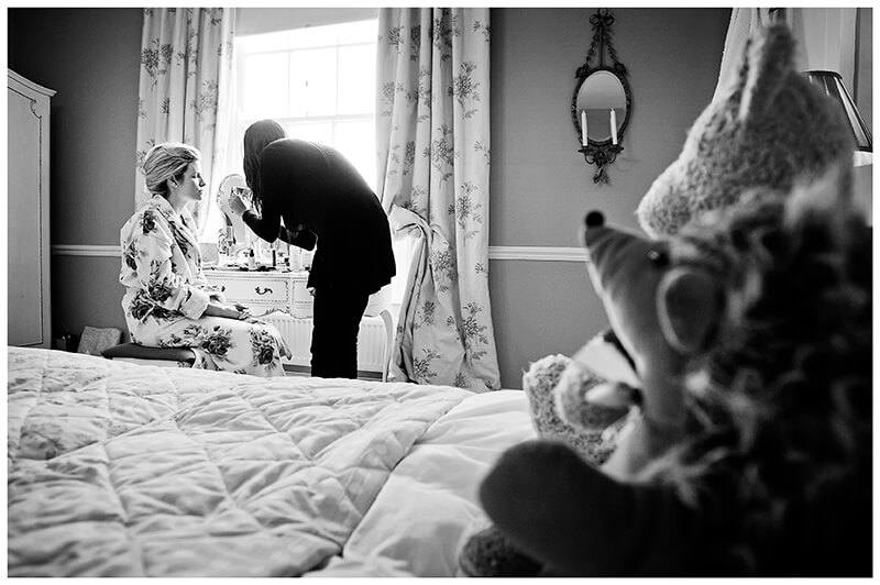 bride getting ready teady bears watching from bed