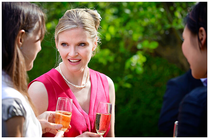 bridesmaid talking to guest