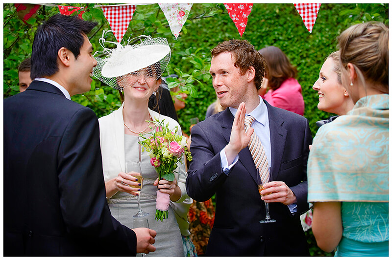 guests talking to groom  during a Garden Wedding reception