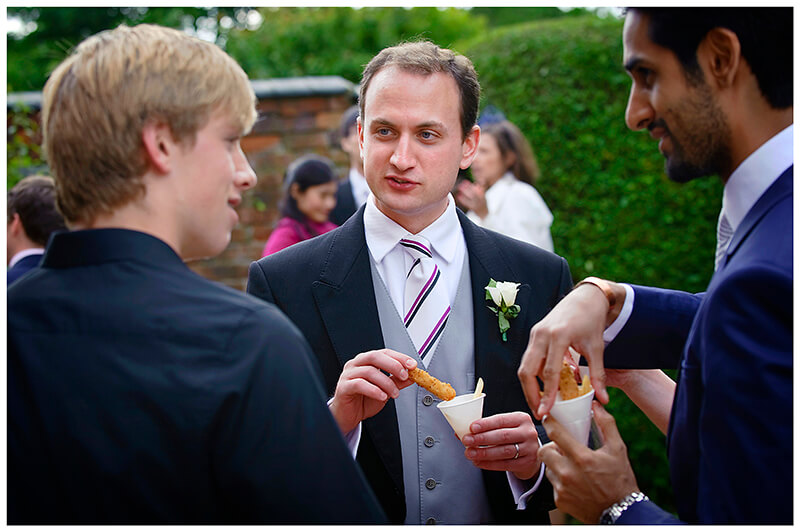 guests helping themselves to chips during a Garden Wedding