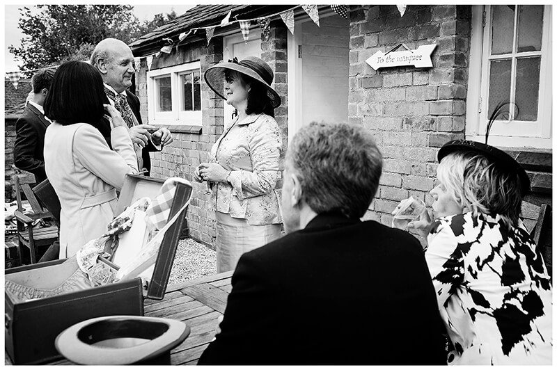 Guests talking in garden at multicultural wedding in Leicestershire