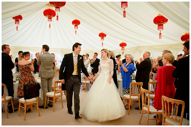 bride and groom enter marquee to guests appluading