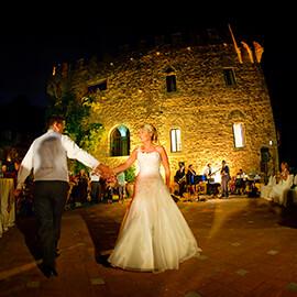 Castello di Vincigliata wedding Italy first dance under night sky in front of castle