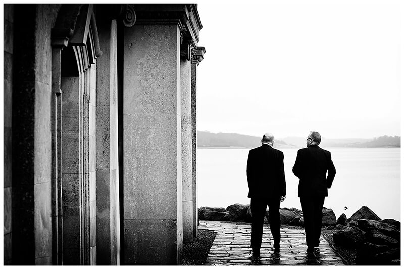 two gentlemen guests walking past side of Normanton Church