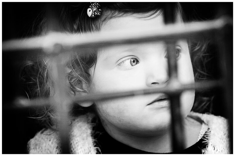 little girl looking through bars from inside Normanton Church