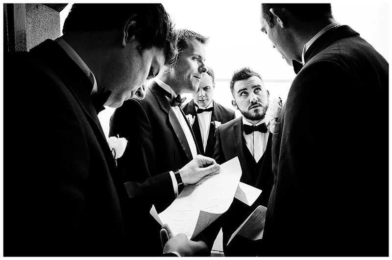 ushers getting instructions from groom