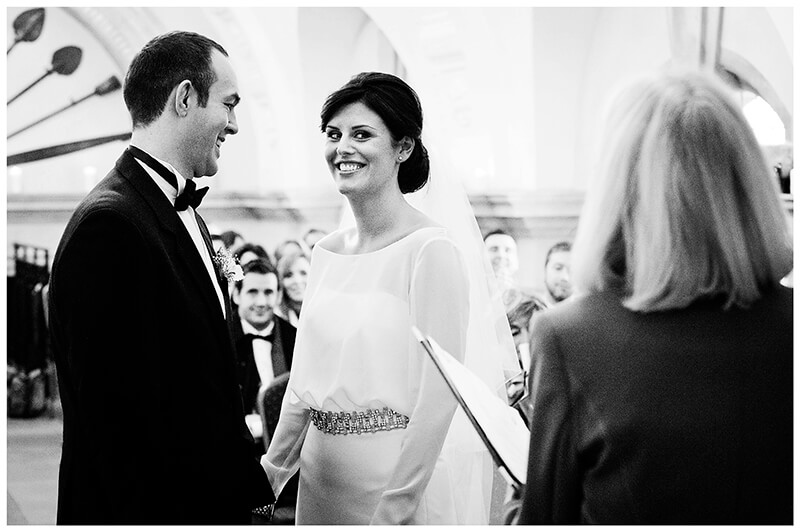 Normanton Church black and white wedding photography smiling bride groom during ceremony