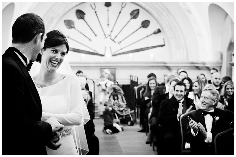 laughing bride at end of ceremony in Normanton Church