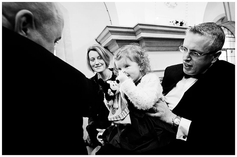wedding guest pinching baby's nose