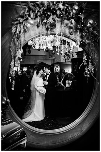 Bride and groom portrait reflected in mirror