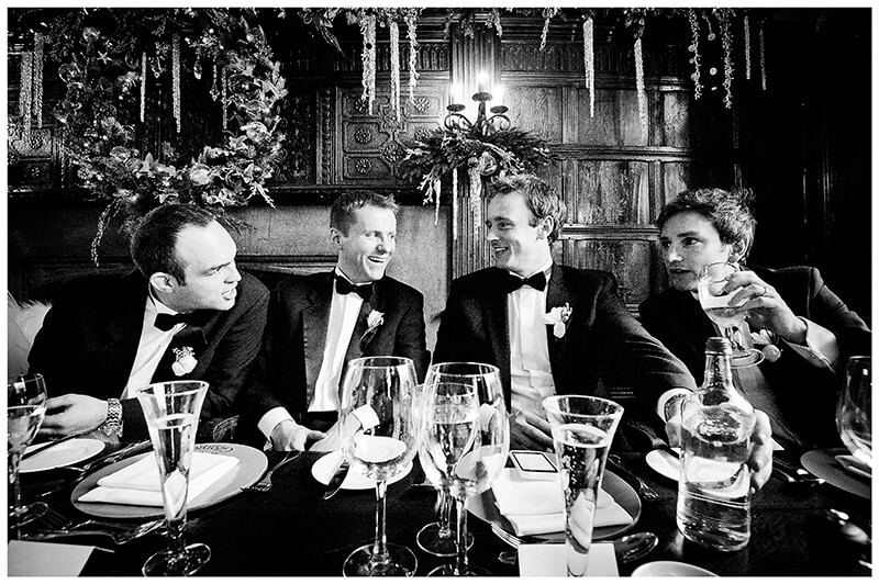 groom with grooms men sat at table