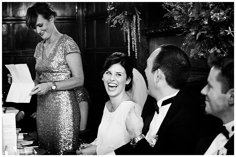 bride laughing during bridesmaid soeech