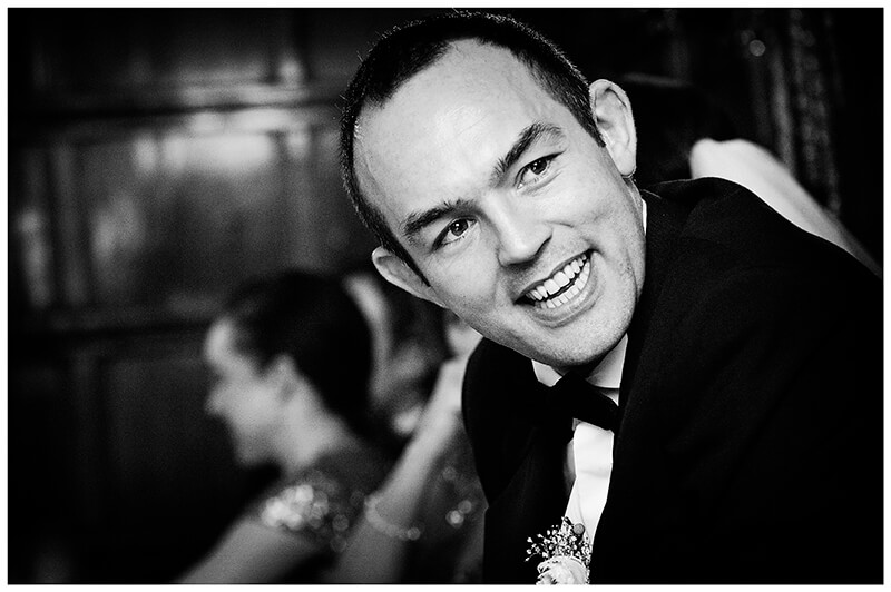 smiling groom unposed portrait