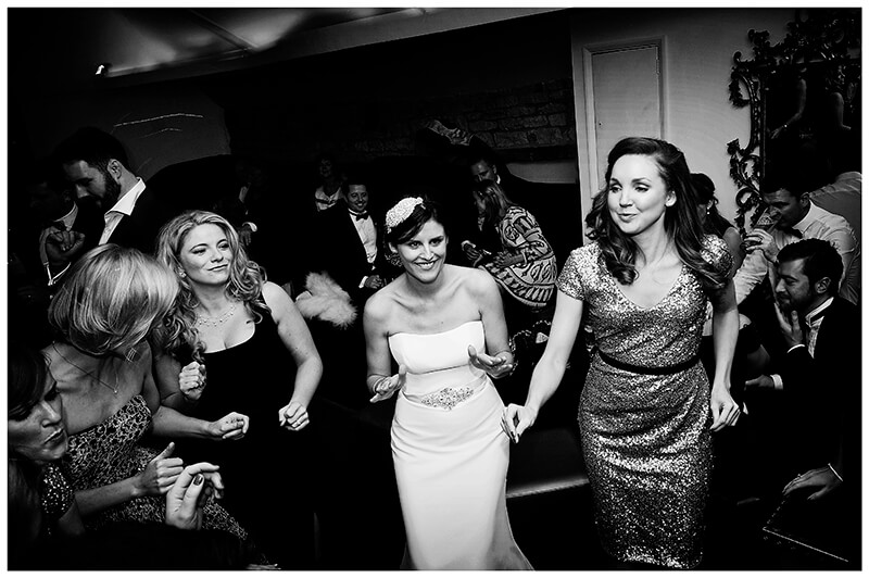 happy bride with her girls on the dance floor