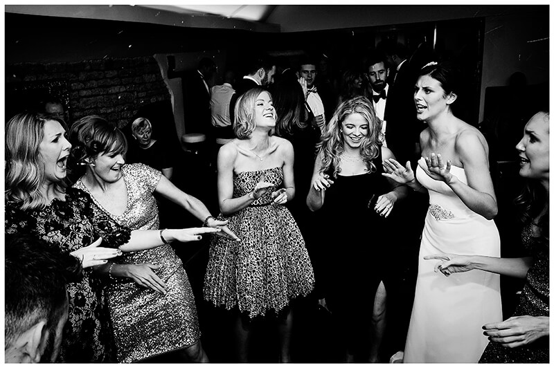 bride and her ladies on the dance floor