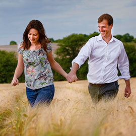 bob & may walking in barley fields cambridgeshire pre wedding shoot