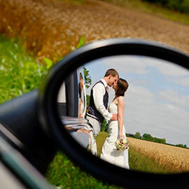 bob & may kiss next to car reflected in car wing mirror childerley hall wedding