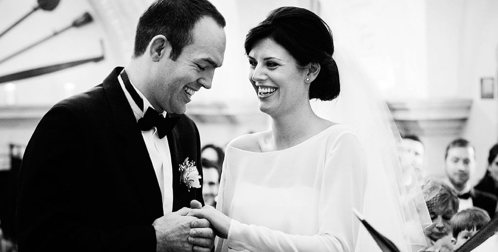 by Creative Cambridgeshire Wedding Photographer Normanton Church Rutland smiling bride groom during vows