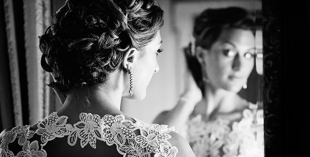 Island Hall Bride looking at hair in mirror by Creative Cambridgeshire Wedding Photographer