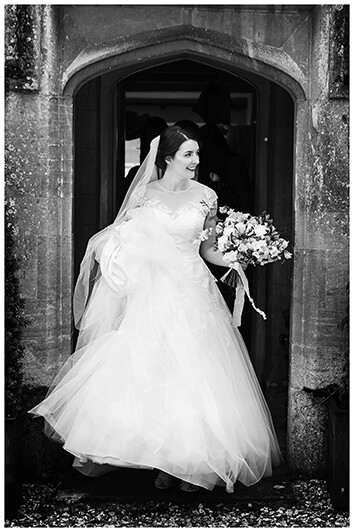 Oxfordshire friars Court Wedding bride comes out of doorway