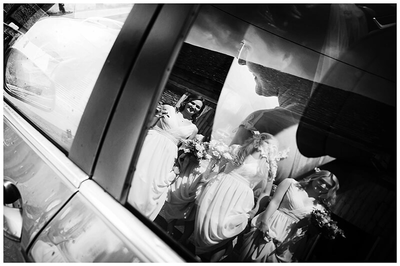 Oxfordshire friars Court Wedding bridesmaids reflected in car window as bride arrives