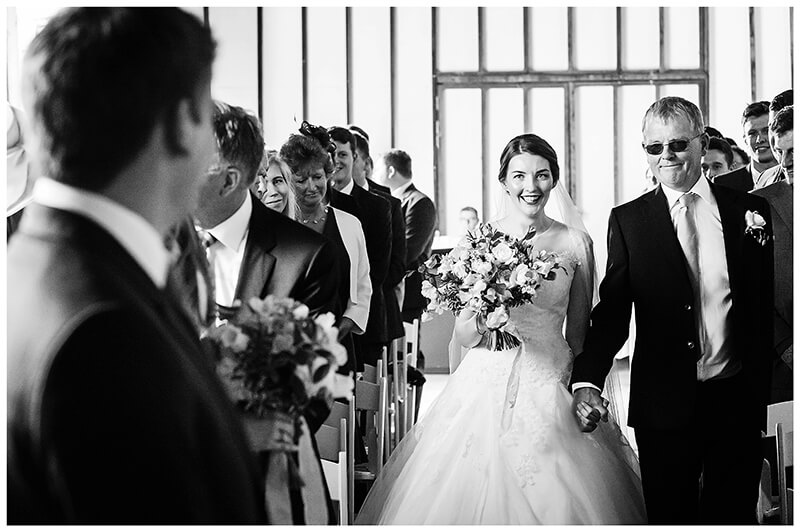 Oxfordshire friars Court Wedding Bride smiles as she reaches groom after walking down aisle
