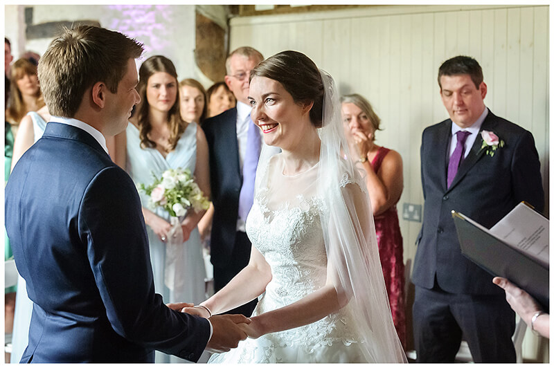 Oxfordshire friars Court Wedding bride groom gaze at each other holding hands during ceremony
