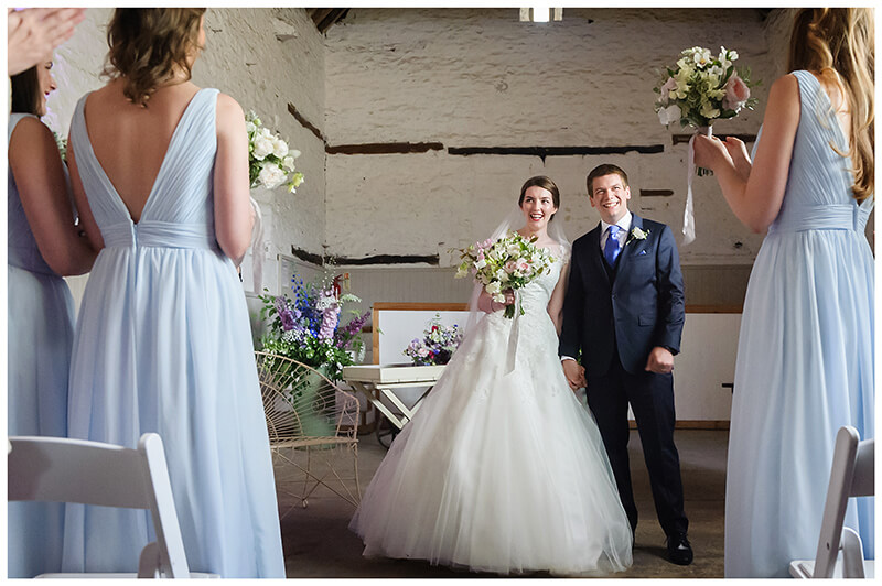 bride groom prepare to walk down aisle at friars Court barn wedding