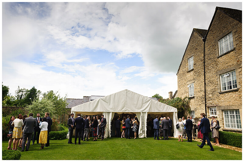 Oxfordshire friars Court Wedding guests in garden an small marquee