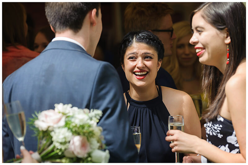 Oxfordshire friars Court Wedding smiling female guests talking to guy