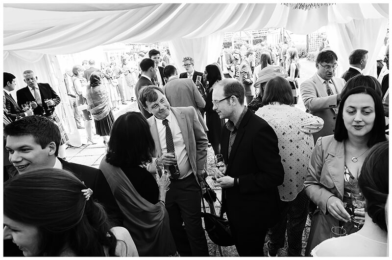 Oxfordshire friars Court Wedding marquee full of guests