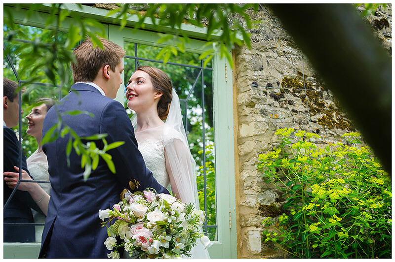 Oxfordshire friars Court Wedding bride groom in gardens in front of door embrace