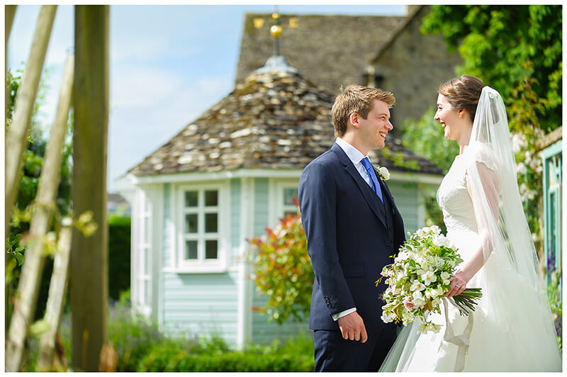 Oxfordshire friars Court Wedding bride groom gaze in to each others eyes standing in front of wooden gazebo