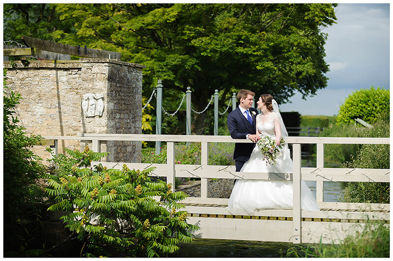 Oxfordshire friars Court Wedding bride groom standing on bridge