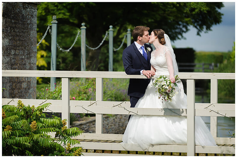 Oxfordshire friars Court Wedding bride groom kiss standing on bridge