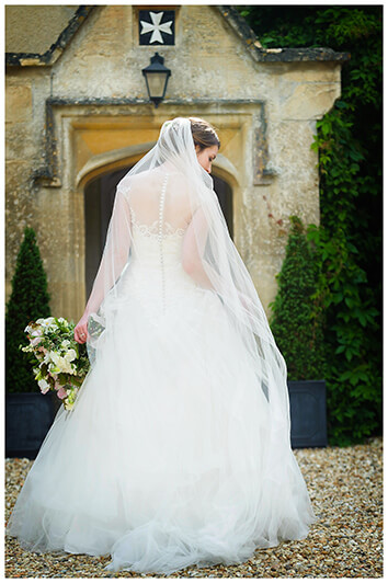Oxfordshire friars Court Wedding bride walking away showing back of dress and veil