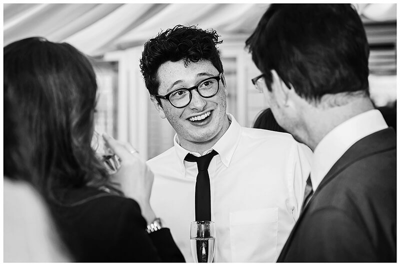Oxfordshire friars Court Wedding smiling male guest in glasses