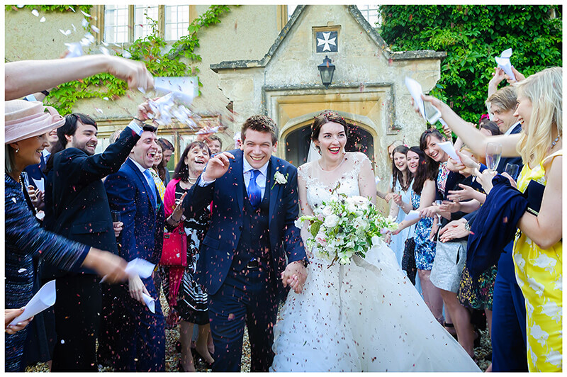 Oxfordshire friars Court Wedding confetti throwing smiling bride groom