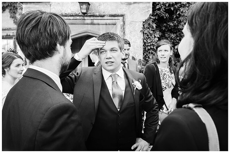 Oxfordshire friars Court Wedding groom looking puzzled