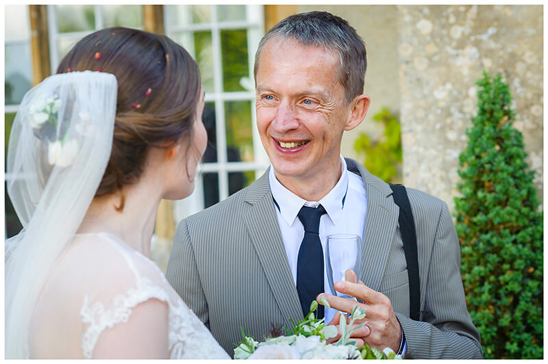 Oxfordshire friars Court Wedding brided talking to smiling gent