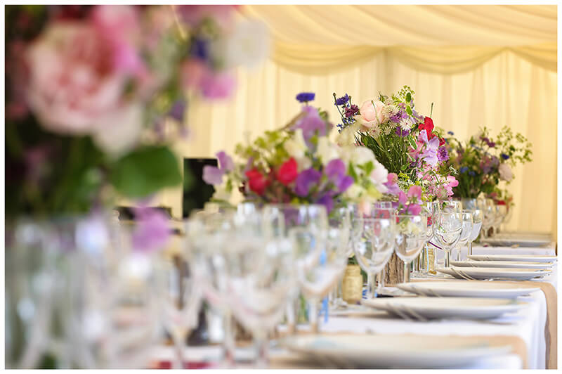 Oxfordshire friars Court Wedding flowers on table in marquee