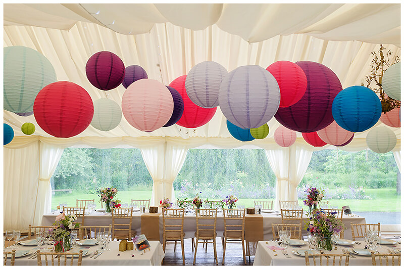 Oxfordshire friars Court Wedding venue marquee decorated with colourful lanterns