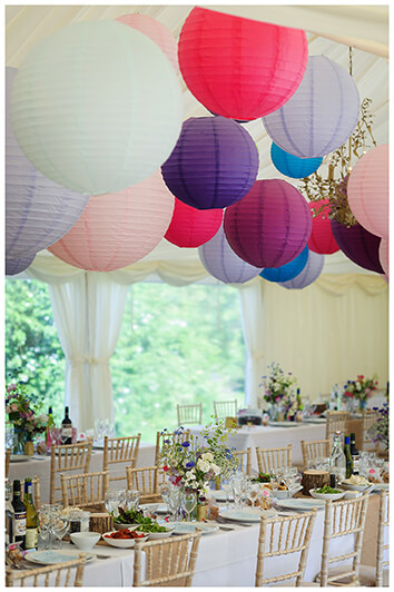 Oxfordshire friars Court Wedding marquee decorated with flowers and lanterns