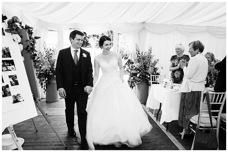 bride groom enter marquee at Oxfordshire friars Court Wedding reception