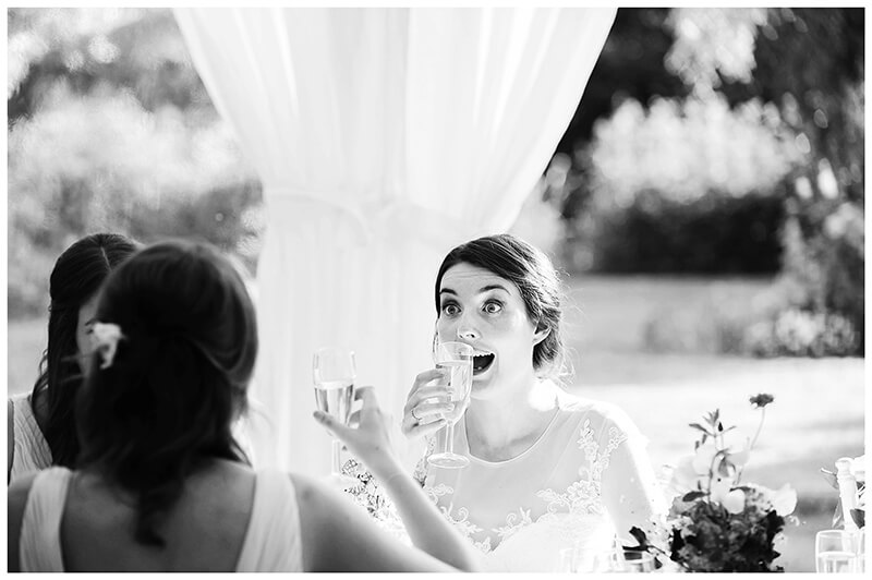 bride faining surprise as she about to drink